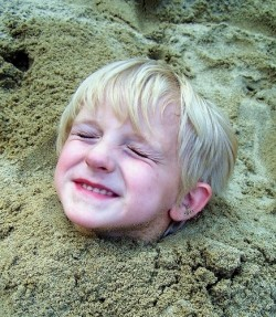 Kid head in the sand