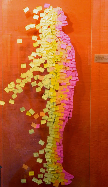 sticky note disintegrating person