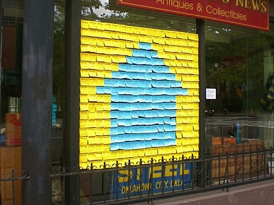 sticky note public art installation on a storefront window